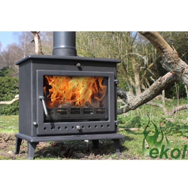 Ekol-Crystal-12-woodburning-mulit-fuel-stove-by-tree
